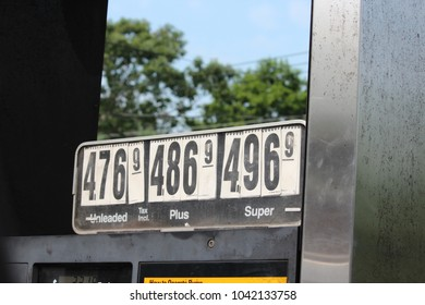 Sign: High gasoline prices at gas station in East Hampton NY USA July 12 2012