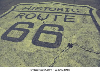 Sign of historic route 66 on the asphalt.