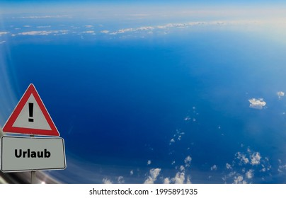 """Sign Holidays german """"Urlaub"""" Looking out of a Plane - Shutterstock ID 1995891935"""