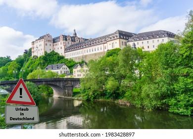 """Sign Holidays in Germany german """"Urlaub in Deutschland"""" City Weilburg Hesse - Shutterstock ID 1983428897"""