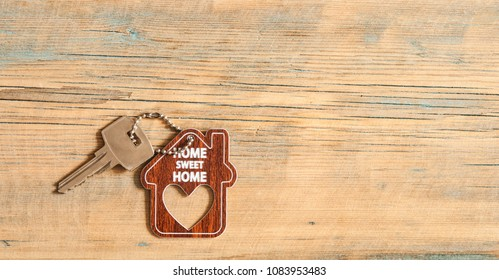 sign home sweet home on rustic wood