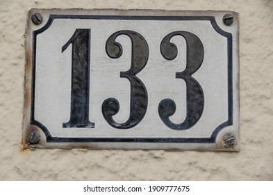 a sign with the house number 133 one hundred thirty three