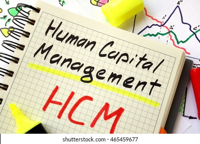 Sign human capital management HCM on a page of notebook.