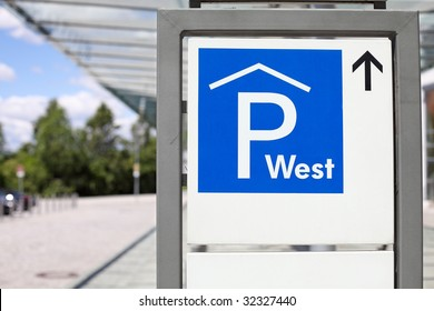 a sign indicating the direction to a car park (closeup)