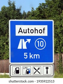 Sign indicating a motorway service area in Germany. With gas station, restaurant and mechanical workshop.