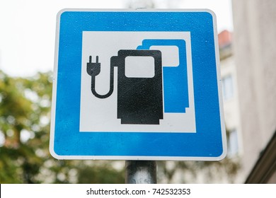 A sign indicating a special place for charging electric vehicles. A modern and eco-friendly mode of transport.