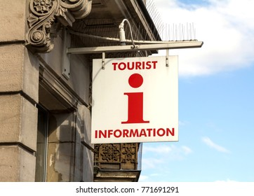 sign indicating tourist office with symbol for information is also shown