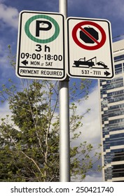 Sign informing about parking days and hours on Calgary's street