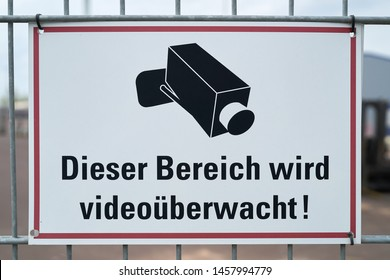 "Sign with the inscription ""This area is video monitored"" at a fence in Germany"
