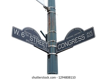 Sign at the intersection of West 6th Street (Pecan Street) and Congress Avenue in the Congress Avenue historic district at the bustling center of Austin, Texas, isolated against white