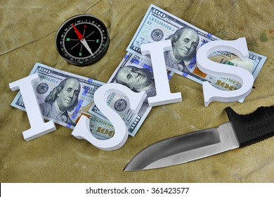 Sign ISIS From Wood Letter Dollar Cash, Compass And Knife On The Weathered Backpack Or Military Camouflage Background