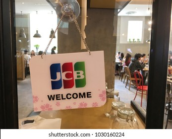 Sign of JCB credit cards accepted and welcome hanging at the front of a restaurant. Photo taken in Bangkok, Thailand in February 2018