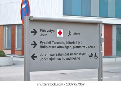 Sign at the Jorvi hospital, Espoo. Päivistys - Emergency, Pysäkit - Bus stops, Jorvin Sairaalan pääsisäänkäynti - Main entrance of Jorvi hospital. Photo taken 04/2018 in Espoo, Finland