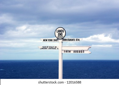 A sign at Lands End, England marking the distance to New York, John O Groats and other places