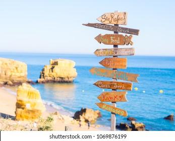 Sign with list of attractions on Praia de Sao Rafael (Sao Rafael beach) in Algarve region, Portugal.
