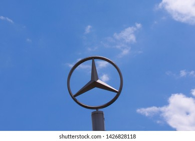 Sign with the logo of Mercedes-Benz Daimler AG. German multinational automobile brand, headquartered in Stuttgart. Copenhagen, Denmark - June 17, 2019