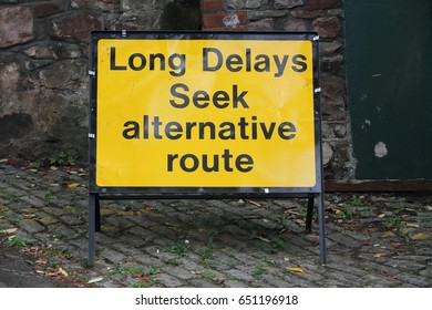 Sign: Long Delays Seek alternative route