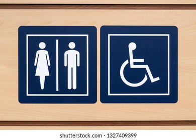 sign of male and female toilet on a background of wood. toilet sign for the disabled. toilet sign for people with disabilities