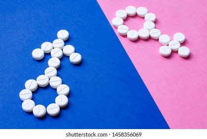 Sign of man and woman from pills on colored background. Concept of female and male health and sexuality. Problems conceiving. Infertility treatment. Sexual problem. Gender sign.