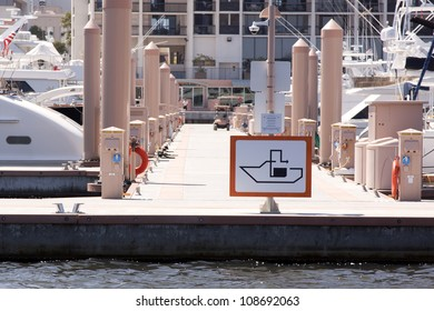 A sign at a marina showing the national symbol used to direct boaters where onshore pumpout services are located.