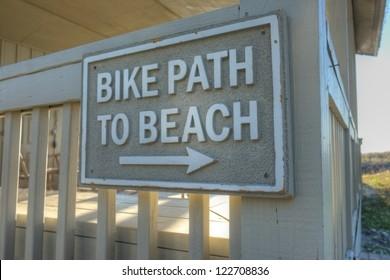 """A sign marked """"bike path to beach"""" near a luxury Atlantic Ocean beach house in Hilton Head, SC."""