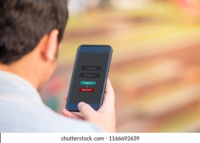 Sign in membership username password concept. Man holding smartphone doing sign in on website at the outdoor.