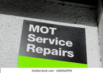 A sign for a MOT testing station in the UK
