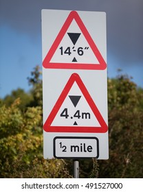 A sign for motorists in Britain warning of a low bridge with imperial and metric measurements displayed near Torness, East Lothian, Scotland on 29 September, 2016.