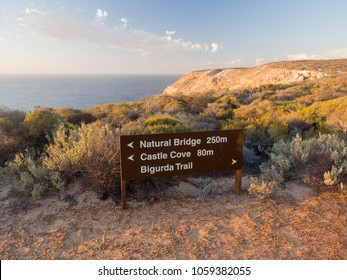 Sign for Natural Bridge and coastal cliffs in Kalbarri National Park, Western Australia