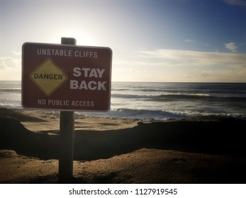 Sign near cliffs by ocean
