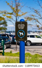 Sign No Dogs Allowed at the Entrance to a Park Playground in Traverse City, USA.