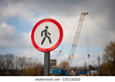 The sign - no pass for pedestrians on sky background and background of repairing.