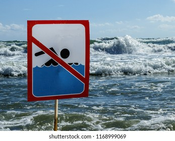 Sign no swim on the beach amid the big waves of the sea