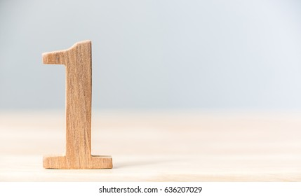 Sign number one material wood on table, Concept top winner success, Copy space - Shutterstock ID 636207029