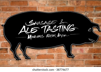 Sign offering sausage and ale tasting at some London's street.