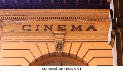Sign for Old Cinema on Stone Arch in Florence
