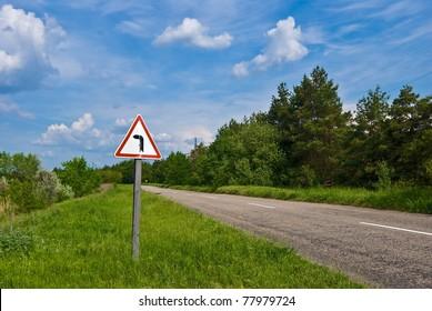sign on asphalt rural road