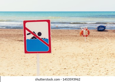 Sign on the beach prohibiting swimming in the sea