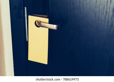 Sign on the black door handle. Empty plate do not disturb.
