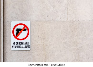 Sign on building stating No Concealable Weapons Allowed