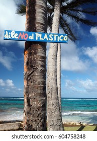 "sign on coconut palm tree saying ""leave no plastics"" on Sally Peachie beach Big Corn Island Nicaragua Central America"