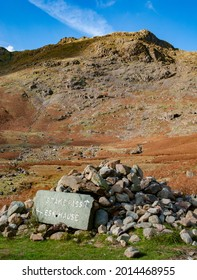 Sign on Cumbria Way at Mickleden Valley, English Lake District for Stake Pass and Esk Hause with cairn foreground and Rossett Pike in background - Shutterstock ID 2014468955