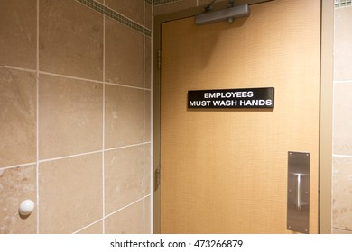 Sign on door for employees to wash hands