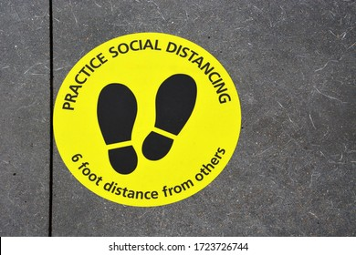 A sign on the floor instructs customers to social distance 6-feet apart during the Coronavirus pandemic in the United States.
