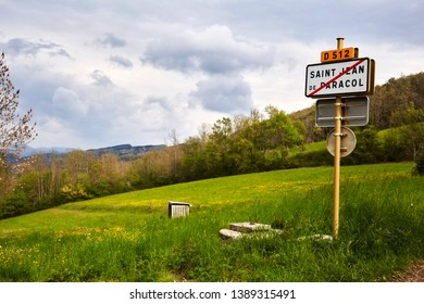 Sign on a hill by a beautiful meadow or prairie, marking the limit of the village of Saint Jean De Paracole a commune in the Aude department, at the foot of the Pyrenees mountain range in south France