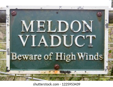 Sign on Meldon Viaduct in Devon, UK warning about the danger of high winds
