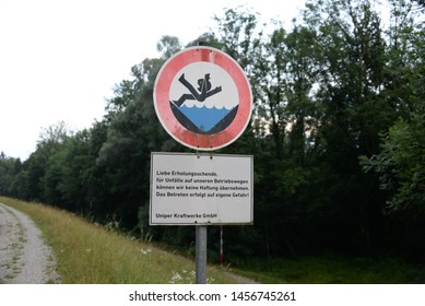 Sign on a moat, pre-layer You can fall in, we assume no liability, Bavaria, Germany, July 2019