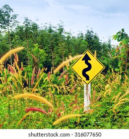 sign on roadside in grass at day, Thailand
