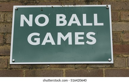 Sign on a wall warning against ball games