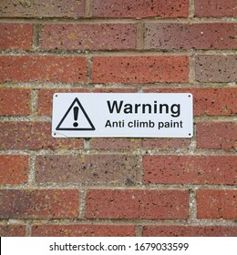 A sign on the wall warning that Anti Climb paint has been used on the premises